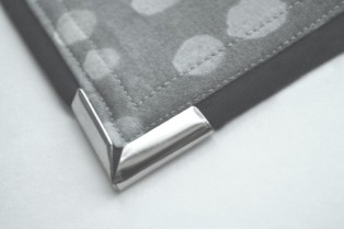 How to Apply Metal Corners on Purse Flaps - http://wp.me/p2ZX0M-Yy