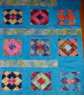 Batik Quilted Blanket - by AmyScrapSpot - https://amyscrapspot.blogspot.com/2016/11/batiks-quilt-top-finished.html