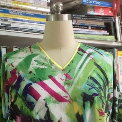 Easy way to Apply Bias Tape to a V neck Tutorial - by Myra at So Sew Easy